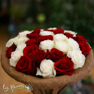 ROUND BOUQUET OF 31 WHITE AND RED ROSES